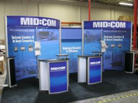 Modified ECO-2029 w/ Modified ECO-5C Podiums, Paradise Fabric Graphics (100% Recycled Content), and LED Lighting -- Image 1