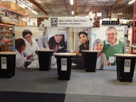 RENTAL: Curved Header with Pillowcase Fabric Graphic and (5) Re-1201 Tapered Counter Workstations with Locking Storage