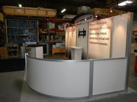 RENTAL:  Modified RE-2021 10' x 20' Rental with RE-1205 Large Curved Counter and Large Monitor Mount -- Image 2