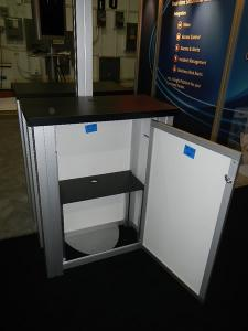 RENTAL:  RE-2008 10' x 20' Design with Arch Canopy, Double-Sided Kiosk using RE-1227 Small Rectangular Counters with Locking Doors & Interior Shelves -- Image 3