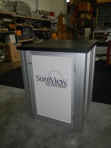 RENTAL:  RE-2008 10' x 20' Design with Arch Canopy, Double-Sided Kiosk using RE-1227 Small Rectangular Counters with Locking Doors & Interior Shelves -- Image 4