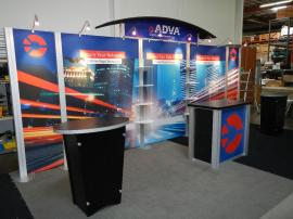 RENTAL:  RE-2009 Arch Canopy, Halogen Arm Lights, RE-1202 Counter, (2) RE-1201 Counters, and Clear Acrylic Shelves. Tension Fabric Graphics, and Sintra Header and Counter Graphics -- Image 2