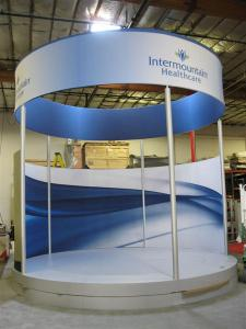 Custom eSmart Exhibit with Circular Header and Stage -- Image 1