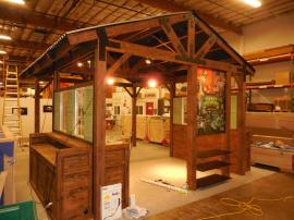 Custom Wood Fabrication Island Display with Storage, Ceiling, A/V, and Lighting -- Image 1