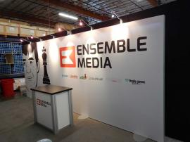 RENTAL: Inline Exhibit with SEG Fabric Graphic, Halogen Arm Lights, and RE-1202 Counter -- Image 1