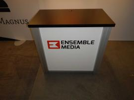 RENTAL: Inline Exhibit with SEG Fabric Graphic, Halogen Arm Lights, and RE-1202 Counter -- Image 4