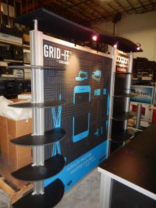 RENTAL: Modified RE-1010 with Custom Rectangular Counter, Custom Black Laminated Shelves, Halogen Arm Lights, Tension Fabric Graphics, and Sintra Infill Graphics for Counters -- Image 2