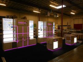 Custom Inline Exhibit with Shelving, Counters, Product Displays, Storage, Lightboxes, and Programmable LED RGB Lighting -- Image 4