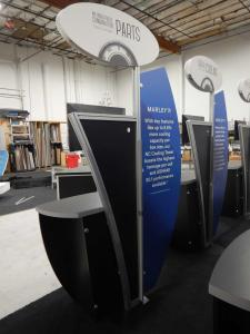 "RENTAL: (6) Custom Kiosks with Sintra Header & Wing Graphics, (6) 24"" Monitors, and (6) DVD Media Players, and RE-1205 Large Curved Counter with Locking Door & Interior Shelf -- Image 3"
