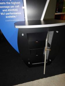 "RENTAL: (6) Custom Kiosks with Sintra Header & Wing Graphics, (6) 24"" Monitors, and (6) DVD Media Players, and RE-1205 Large Curved Counter with Locking Door & Interior Shelf -- Image 4"