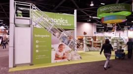 RENTAL:  Modified RE-9020 Double-Deck with Counters, Product Displays, Graphics, and an Overhead Hanging Sign -- Image 4