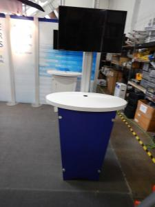 RENTAL: RE-2009 with Arch Canopy, Halogen Arm Lights, RE-1202 Reception Counter with Locking Door & Interior Shelf, (2) RE-1201 Counters, (2) RE-1223 Kiosks with Monitor Mounts, Tension Fabric Graphics, Sintra, Header and Counter Infill Graphic -- Image 2