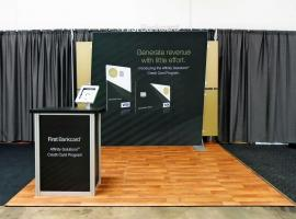 Custom SEGUE Exhibit with SEG Graphics, iPad Stand, and MOD-1551 Counter with Storage