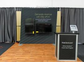 Custom SEGUE Exhibit with SEG Graphics, Monitor Mounts, iPad Stand, and MOD-1551 Counter with Storage
