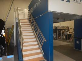 RENTAL: RE-9020 Medium Deck with Angled Staircase Graphic Frames and Sintra Stair Risers.