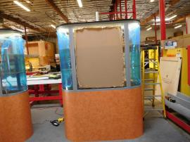 Custom Modular Oval Showcases with Internal LED Lighting, Shelves, and Locking Storage