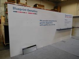 Continuous Laminated Inline Wall with Graphics, Shelf, and Monitor Mount