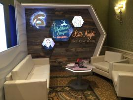 Custom Wood Fabrication and Gravitee Modular Exhibit with LED Graphics, Edge Lighting, and Charging Table with Graphics