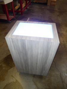 Custom MOD-1565 Product Pedestal with Acrylic Uplighting, LED Perimeter Light, and Locking Storage
