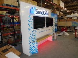 Custom Exhibit with (2) Monitor Mounts, Dimension Letters and Logo, LED Accent Lights, Storage, and Shelf