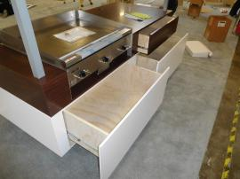 Custom Grilling Demonstration Station with Mirrored Ceiling and Storage Drawers
