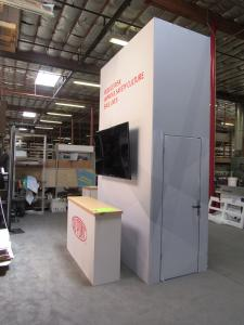 Modified VK-5166 Island Exhibit with Gravitee Tower, Walk-in Storage, (2) Workstation Kiosks with Monitor Mount and Locking Storage, and (6) Custom Counters with Storage