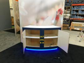 RENTAL: Modified RE-9094 Island Gravitee One-Step System Design with Large Monitor Mount, Large Custom Curved Counter, SEG Fabric Graphics, and Vinyl Counter Graphics